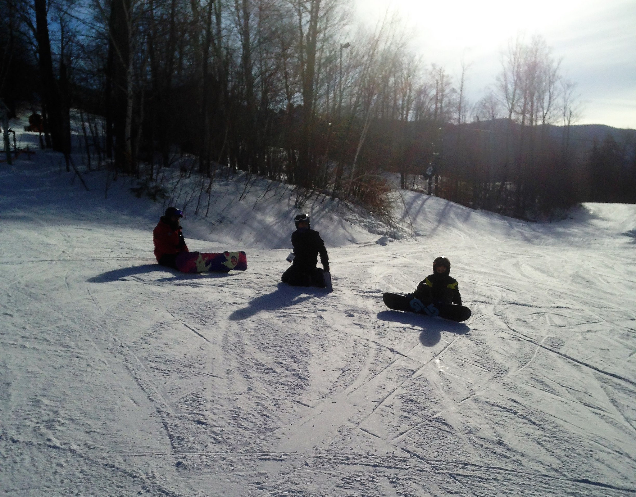 winter activities - snowboarding family in vermont, smugglers notch resort