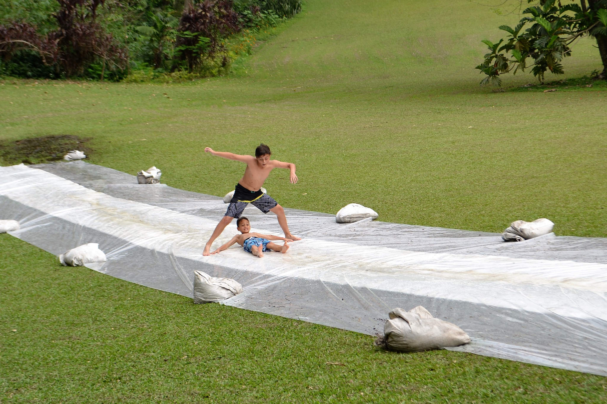 brothers, huge water slide, country retreat fun