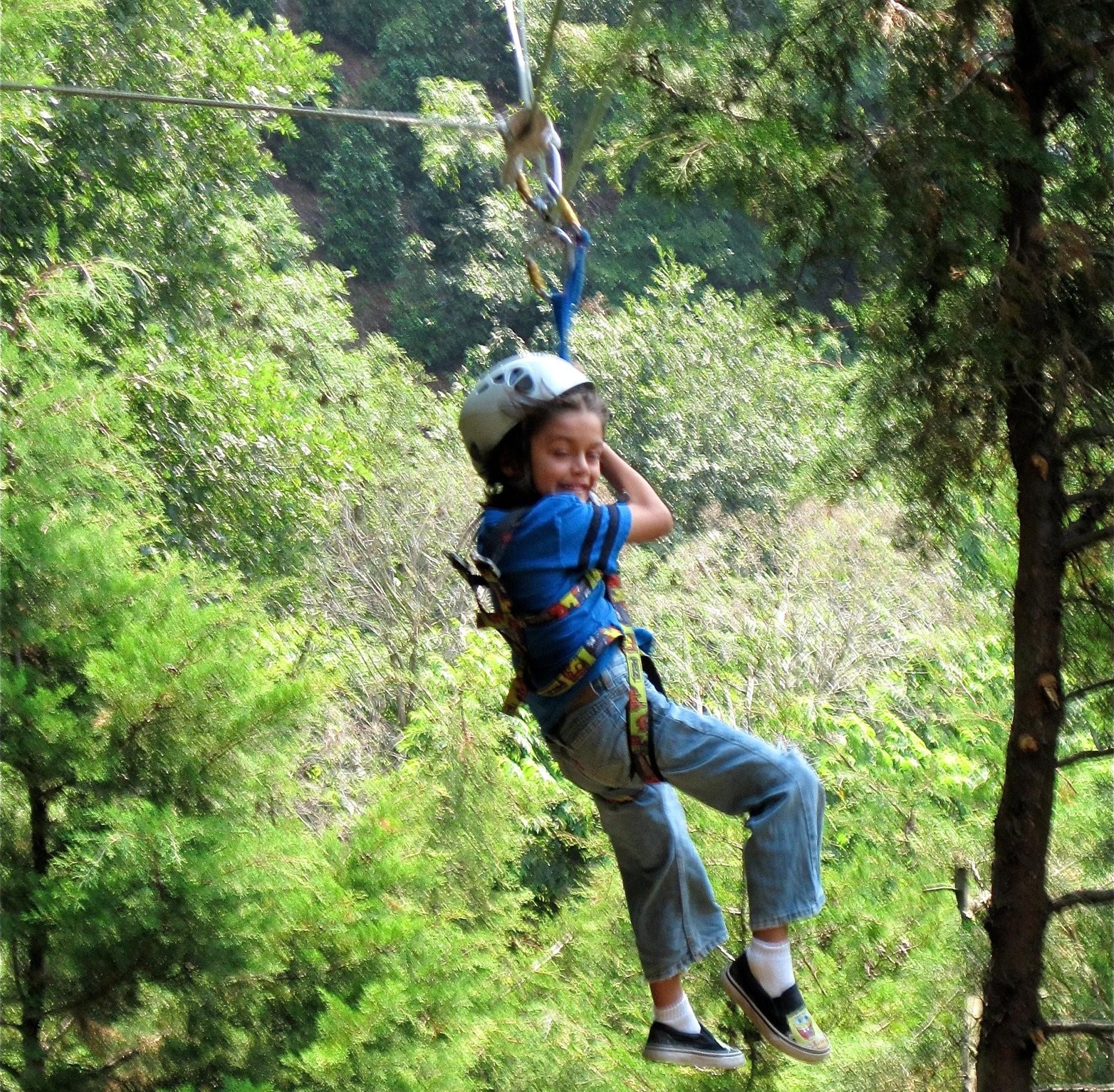 kid zip lining in Monteverde, Costa Rica