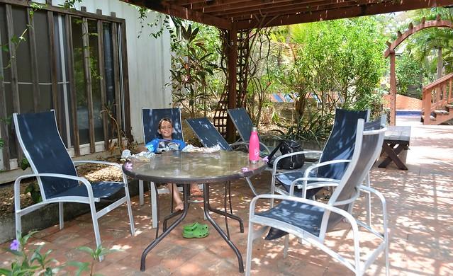 kid sitting in a backyard in roatan honduras
